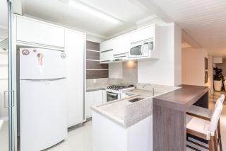 Balneário Camboriú: Apartamento com área privativa de 127 m², 3 suítes, sacada com churrasqueira, 1 vaga de garagem 6
