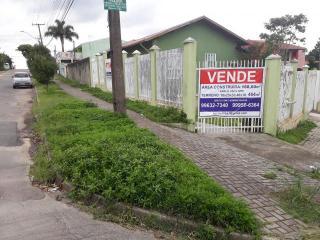 Curitiba: Imóvel de esquina com ampla área de estacionamento 1